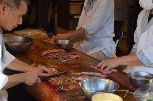 Japanische Köche, Arbeitstheke, Fisch