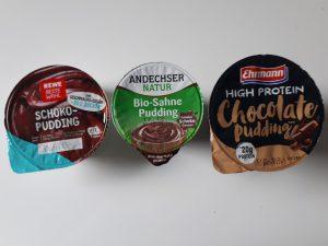 Drei Puddingbecher Rewe, Andechser und Ehrmann